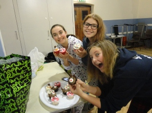 Walton-on-Thames youngsters putting their faith into action by making (and eating) cakes.