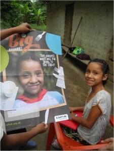 Mayling and her cousins laughed when they saw her in last year's primary schools Harvest Fast Day poster