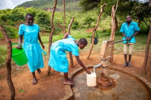 Girls at a water pump Uganda