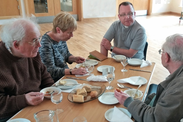 Fr Chris Spain with parishioners enjoying the soup lunch