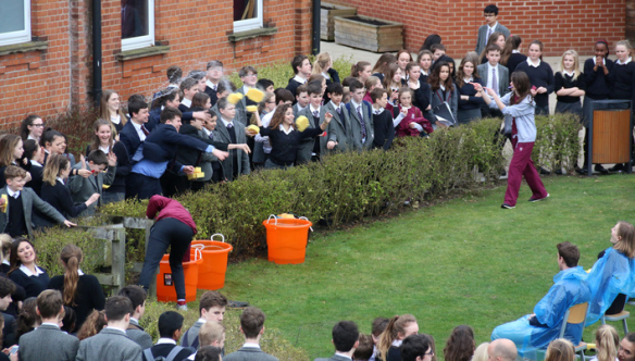A crowd of St George's pupils soaking their teachers