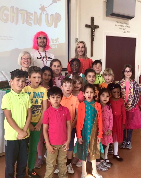 Children of St John's with Maria, Martin and Head Teacher Mrs Bono