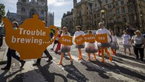 CAFOD and Oxfam campaigners campaigning about Sainsbury's 'Fairly Traded' Tea