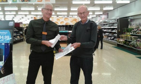 Rod Thick from Worthing speaking to the Manager of his local Sainsbury's store about the importance of Fairtrade