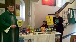 Libia Rolden and Rev. Michael Hynes man Lydia's Fairtrade Stall at St Anne's, Chertsey