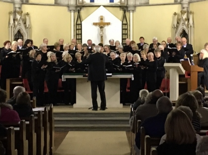 The Sandgate Singers Choir singing in support in Storrington