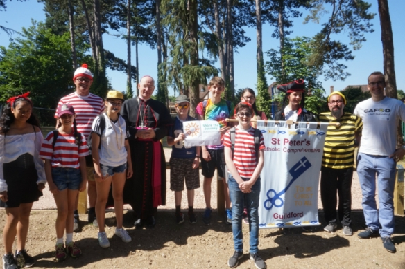 St Peter's students, Head Teacher, Chaplain and Bishop Richard before they set off on their fancy-dress Share the Journey walk.