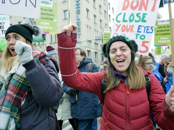 CAFOD campaigners Hannah Jordan and Harriet Rees at COP24 rally Credit Rosie Heaton